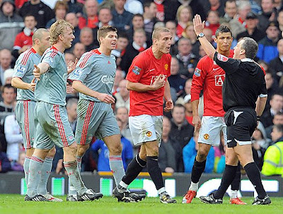 Manchester United's Portugese midfielder Cristiano Ronaldo (second right) appeals to referee Alan Wiley (right) after Serbian defender Nemanja Vidic (third right) is sent off against Liverpool.