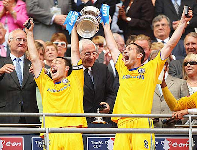 Captain John Terry of Chelsea lifts the trophy with Frank Lampard.