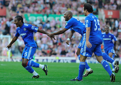 Florent Malouda of Chelsea celebrates scoring the winning goal with his team mates