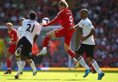 Fernando Torres of Liverpool competes for the ball against Andre Bikey of Burnley