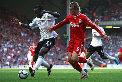 Fernando Torres of Liverpool (right) competes for the ball against Andre Bikey (left) of Burnley. Liverpool romped to a 4-0 victory.