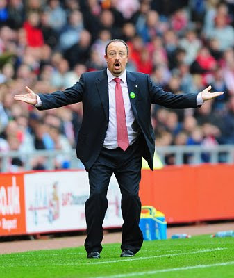 Liverpool manager Rafael Benitez reacts after a goal, that deflected off a beachball, went against them. Liverpool lost 1-0.