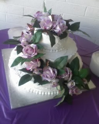 Silk rose flowers cascading around the cake Labels cake wedding