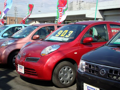 Cars for sale at a Japanese showroom