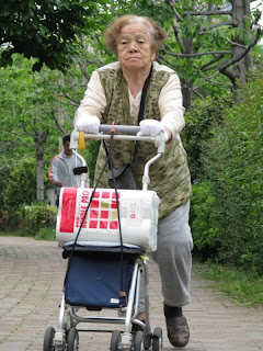 Elderly woman with shopping, Tokyo.