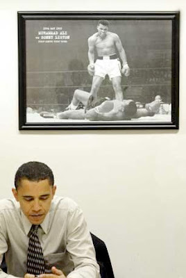 Barack Obama under photo of Muhammad Ali