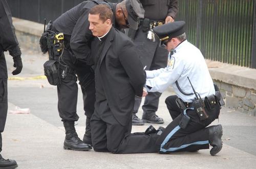 លទ្ធផលរូបភាពសម្រាប់ priest in handcuffs