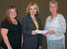 Maggie, Rhonda presenting Check from 2008