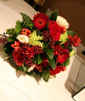 The Handle of the wedding bouquet was bound with Red White Polka Ribbon