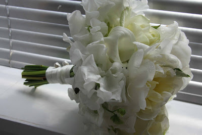 within the heart of the bouquet are a few beautiful white call lilies