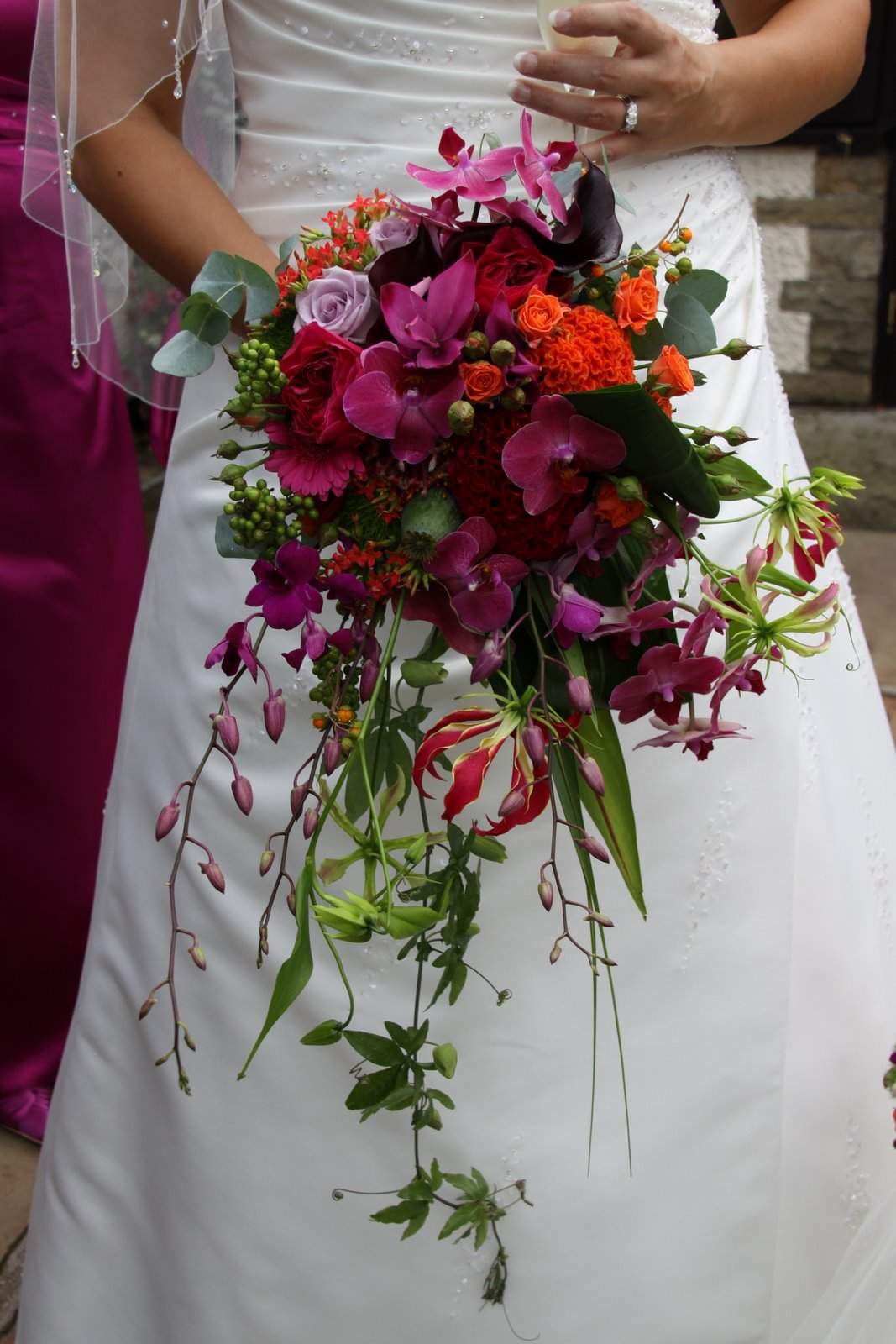 The Flower Magician Vivid Hot Pink Orange Cascade Wedding Bouquet