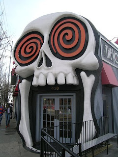 night time photo of the giant skull facade on The Vortex bar and grill
