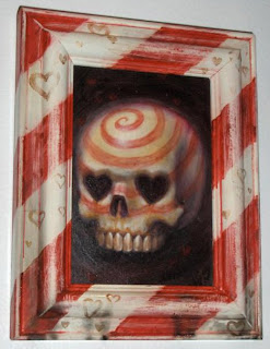 painting of a skull with heart-shaped eye sockets