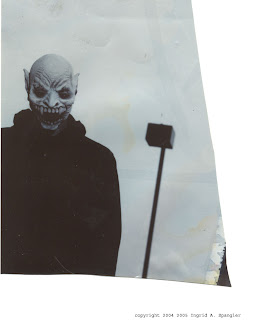 photo fragment of a man wearing a Halloween mask
