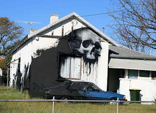 House with giant skull painted on the side