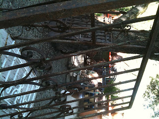one of a pair of old rusted gates