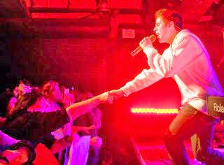David Archuleta touching hands of fans