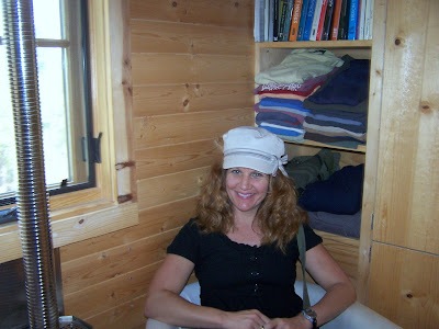 me sitting in the front room of the tumbleweed tiny house and snap below in the kitchen boulder tiny house front