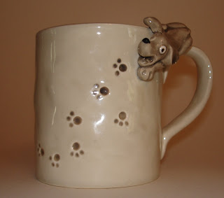 mystery dog mug with foot prints