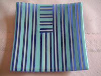 Dark blue, light blue, mauve fused glass strip plate