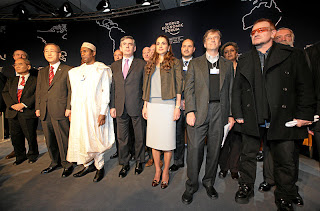 Gates (second from right) with Bono, Queen Rania of Jordan, British Prime Minister Gordon Brown, President Yar Adua of Nigeria and other participants in a 'Call to Action on the Millenium Development Goals' during the Annual Meeting 2008 of the World Economic Forum in Davos, Switzerland.