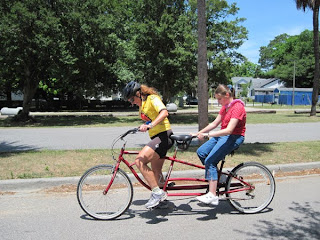 Shelby tandem biking with a sighted pilot