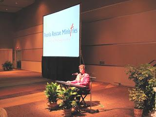 Laurel presents for Peoria Rescue Ministries Annual Banquet