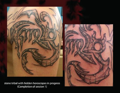 stone tribal with hidden horoscopes tattoo