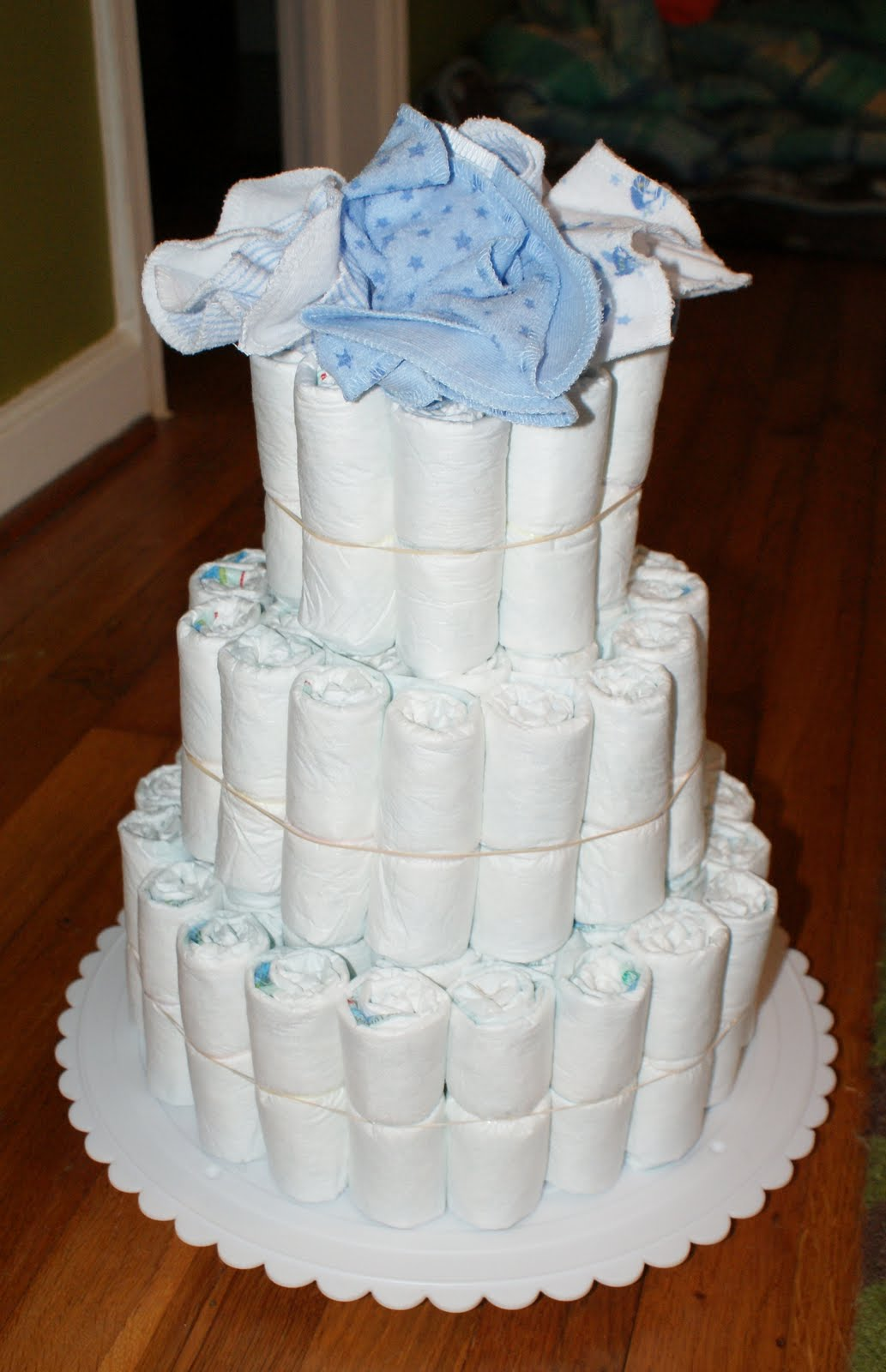 Cake Shaped Like a Diaper http://www.householdhabits.com/2012/07/diaper-cakes.html