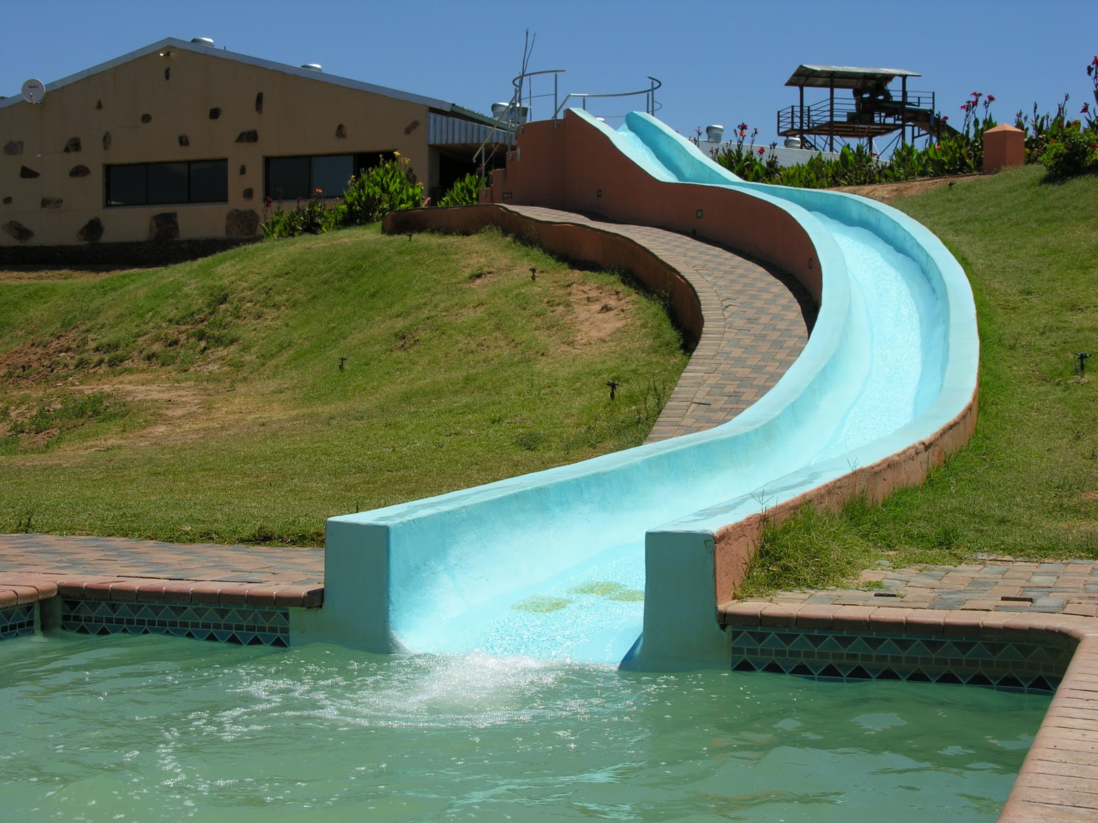 Big swimming pools with slides style for Giant swimming pool