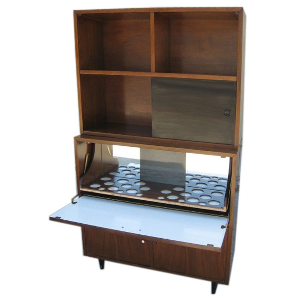 ours doesn't. That's one very versatile mid-century liquor cabinet