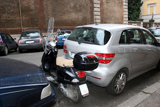 scooter between cars