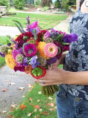 Bride bouquet, bright, Ann Arbor, Floral, Florist, Wedding, Sweet Pea Floral Design, Michigan, outdoor, earthy, once wed, 100 layer cake, indie,Orange dahlia, coral zinnia, fuchsia anemone, purple sweet pea, red cockscomb, red and green ranunculus, scabiosa pods, english lavender, and veronica