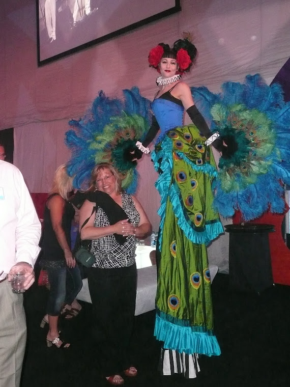 Peacock Lady on Stilts