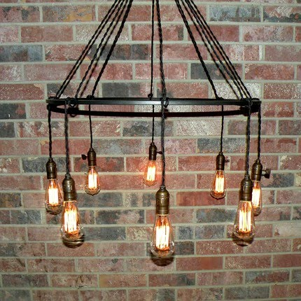 M v movement modern take on vintage lighting chandeliers perfect for lofts with high ceilings the vintage minimalist ring chandelier is basic but not boring the carbon filament bulbs are both industrialurban mozeypictures Image collections