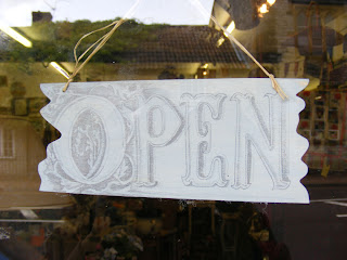 My open sign. I doodled this, but haven't got around to putting closed on the back