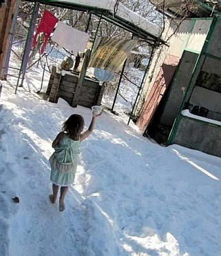 barefooted child on snow