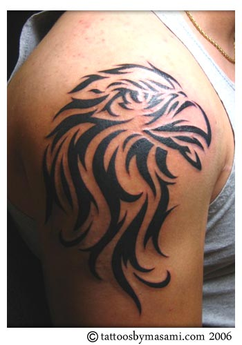 Tattoo of a Eagle tribal on the Shoulder