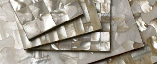 Mother-of-pearl tiles good for a bathroom or a yacht, or a bathroom in a yacht.