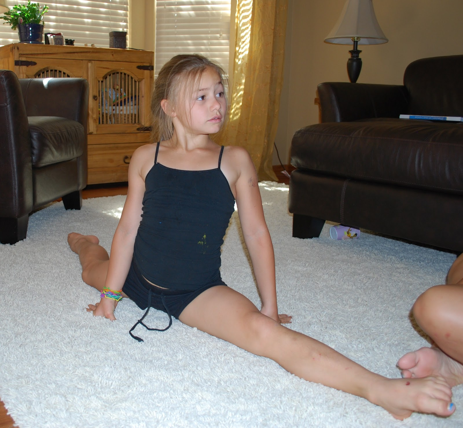 "In the world of 8-year old gymnasts, my daughter is ""tight"". This is"