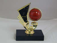 youth intramural basketball participation trophy with a spinning figure