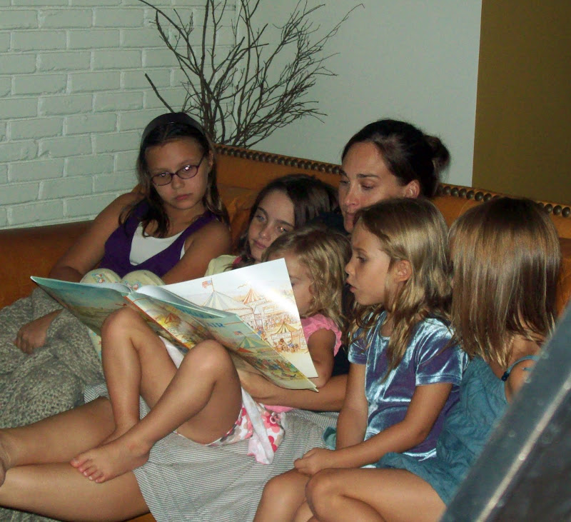 Cassie reading to the little girls before bed. title=