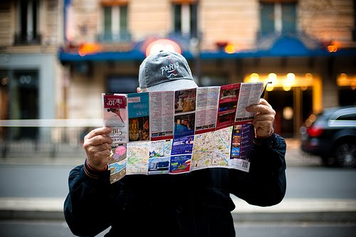 american tourist in paris with map