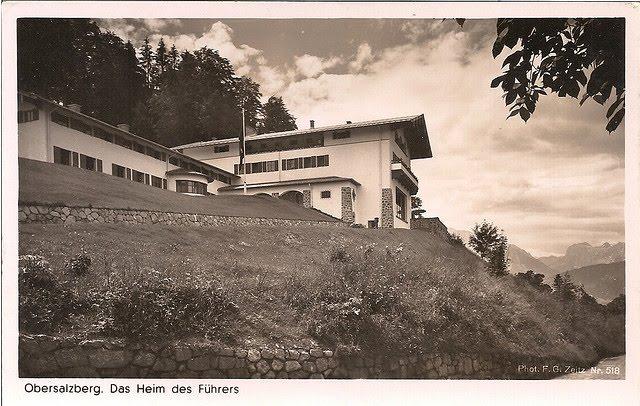 Berghof fue el lugar de descanso y segunda residencia gubernamental de Adolf Hitler en Obersalzberg, en los Alpes Bávaros cerca de Berchtesgaden, Alemania.  Fue su refugio en 1924, al salir de prisión inmediatamente después del Putsch de Múnich, posteriormente su lugar de residencia en la que estuvo, durante la mayor parte de la Segunda Guerra Mundial, además de ser uno de los Cuarteles Generales del Führer más conocidos1 que se extendían por toda Europa.  Índice      1 Los orígenes     2 Referencias     3 Véase también     4 Enlaces externos  Los orígenes  La casa estaba ubicada entre los 900 y 1000 metros (2.952 - 3.280 pies), perteneciendo al ciudadano alemán Hans Wachenfeld a principios de siglo XX. En 1924 se la alquiló a Adolf Hitler quien para la época era un agitador de masas, recién salido de la cárcel, luego del fracasado Putsch de Múnich. En esta casa, se refugió Hitler mientras el NSDAP se reconstruía en 1925. Posteriormente vivió de manera alternativa entre Munich y la casa. En 1927, con los fondos del Partido logró comprar la casa y mudó a su media hermana Angela Raubal con la intención de que la cuidara y fungiera como ama de llaves y administradora general.   Adolf Hitler descansa en uno de los cuartos del Berghof, en 1936  El Berghof era en principio una modesta casa alpina de madera común y corriente y se la conocía como Haus Wachenfeld. Reconstruida, ampliada y remodelada entre 1934 y 1936, Berghof como tal, se amplió a poco más de 30 cuartos y fue dotada con amplios voladizos. Solo el ala-oeste de la casa original fue dejada incólume.2 La primera planta fue destinada al dormitorio de Hitler y de Eva Braun, una amplia sala de estar con un gran ventanal y que le permitía además ver películas a gusto, la decoración fue a cargo del arquitecto Troost. Por lo general, el ambiente que se imprimía en el Berghof era más bien familiar que gubernamental y estaba hecho a la medida de Hitler.  Tuvo función como residencia cerca de poco menos que veinte años. 