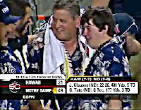 Charlie Weis and his son following ND's Hawaiian Bowl victory