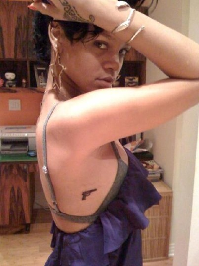 bikini line tattoos. guns tattoos. rihanna hand