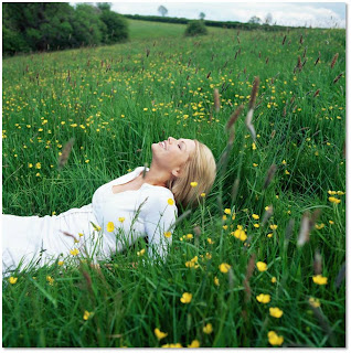 A woman laying in an opened field