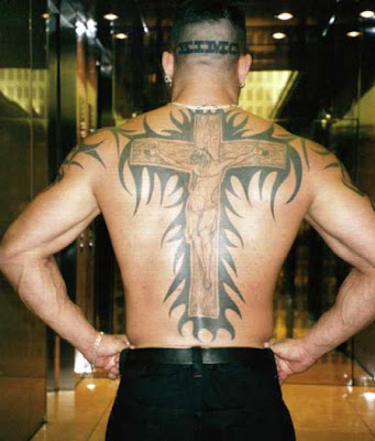 He also had a religious tattoo that would put Kanye's bling to shame,