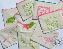 Selection of handprinted purses with contrast zips and patterned linings