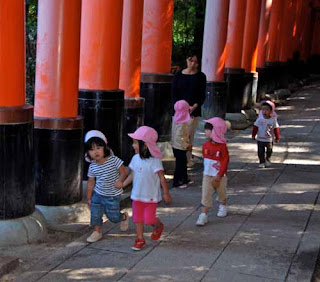 Japanese Children Walking the Torri Gates  at Fushimi-Inari Shrine